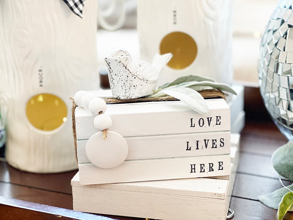 love lives here book stack close up faux book stack dollar store farmhouse craft
